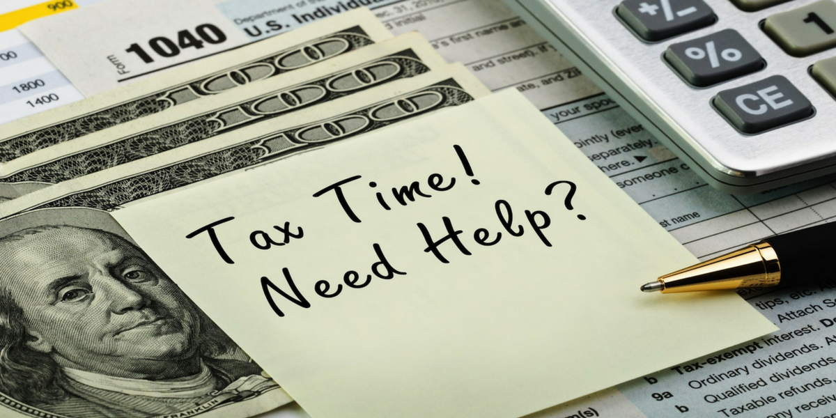 "Slide with money and calculator that reads, ""Tax Time! Need help?"" on a sticky note"