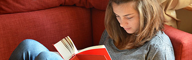 Teen girl reading a book